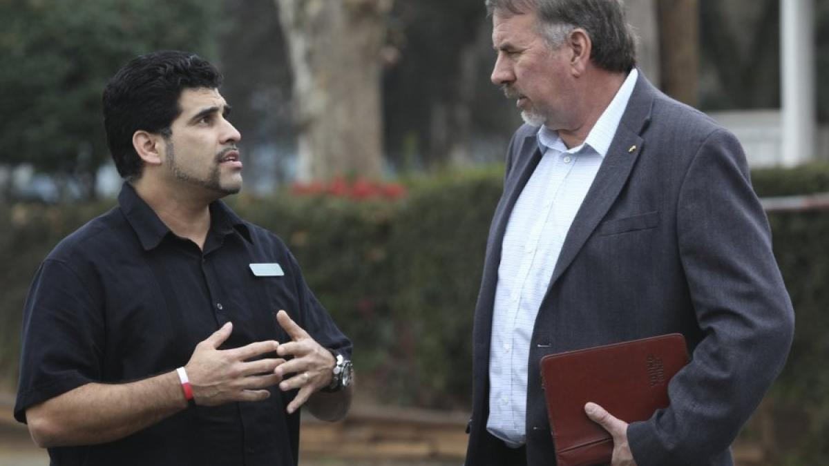 Greg Barnette/Record Searchlight Good News Rescue Mission Food Services Manager Daniel McAllister, left, talks with Rep. Doug LaMalfa on Wednesday.